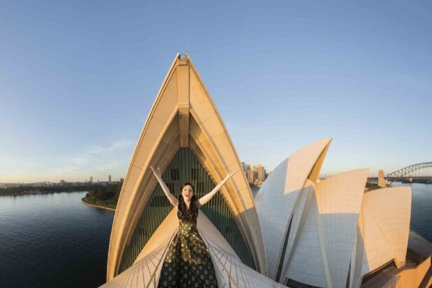 Lorina Gore at first light aloft the Sydney Opera House for Opera Australia