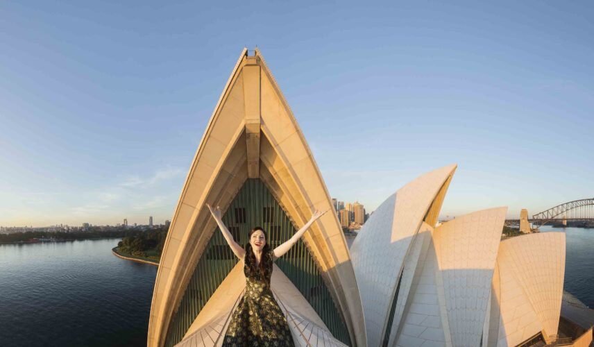Lorina Gore at first light aloft the Sydney Opera House for Opera Australia